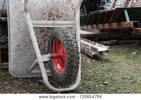 construction yard tools and materials wheelbarrow close up