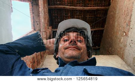 a smiling Construction worker under a roof