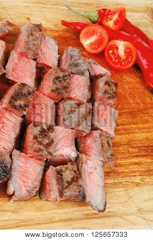 american meat : big rare roast steak on wood isolate on white background