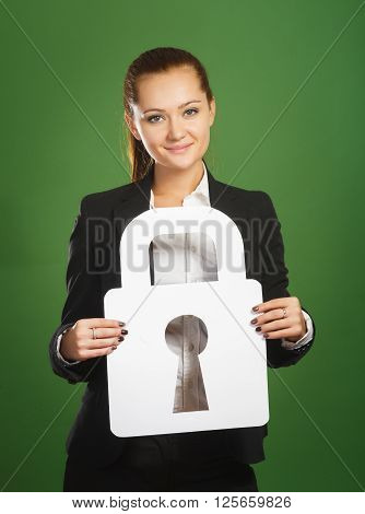 Business Woman Holding Paper Lock On Green Background