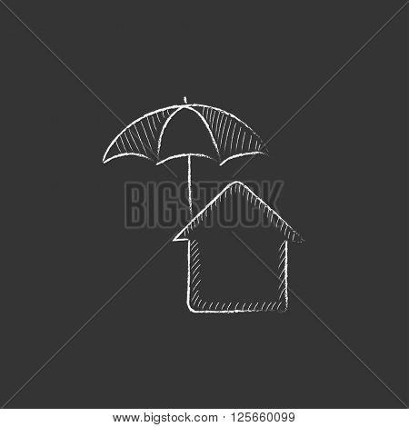 House under umbrella. Drawn in chalk icon.