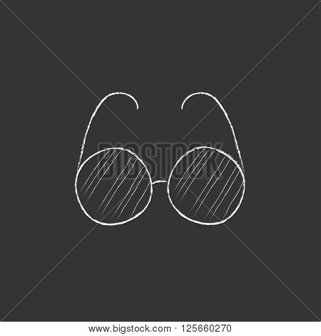 Eyeglasses. Drawn in chalk icon.