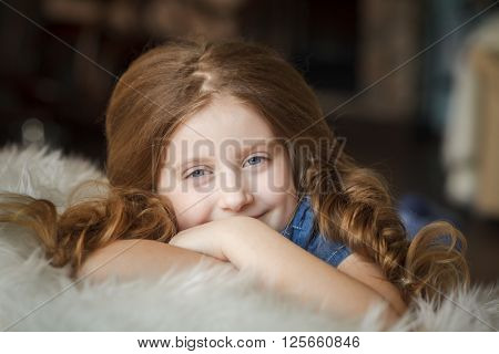 Cute little girl with braids. Stock photo.