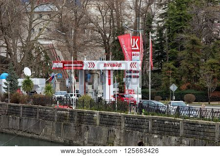 Sochi, Russia - February 8, 2016: Lukoil gas station with fueling car. LUKOIL - one of the largest Russian oil company.