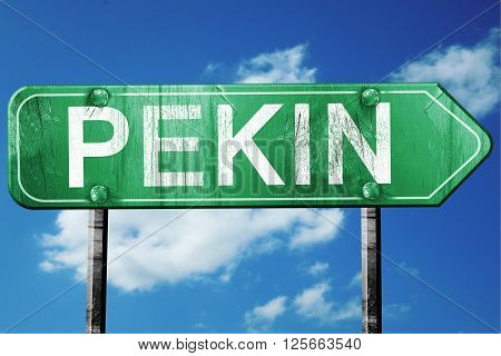 pekin road sign on a blue sky background