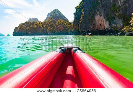 Canoeing in Phang nga bay along the large limestone rock Thailand