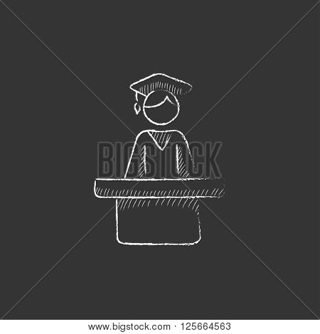 Graduate standing near tribune. Drawn in chalk icon.