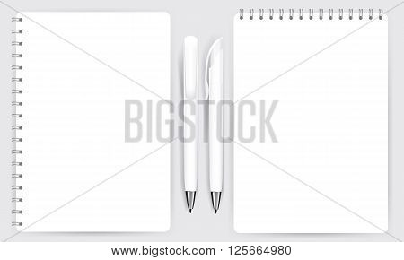 Blank realistic spiral notepad notebook and white pen isolated on white vector. Display Mock up for coporate identity and promotion objects.