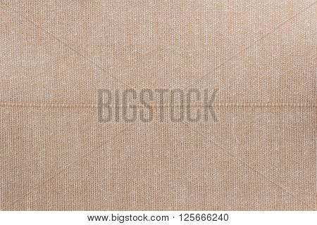 Bege towel fabric. Tablecloth texture. Cotton texture closeup background