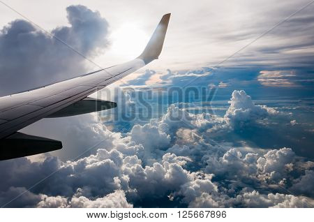 View from Airplane window fly over the Cumulonimbus cloud bird eye view in the morning over the Andaman sea Thailand