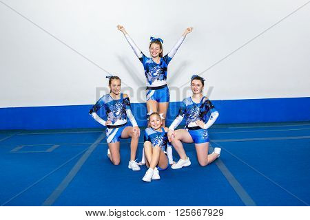 A Portrait of beautiful cheerleaders  in action