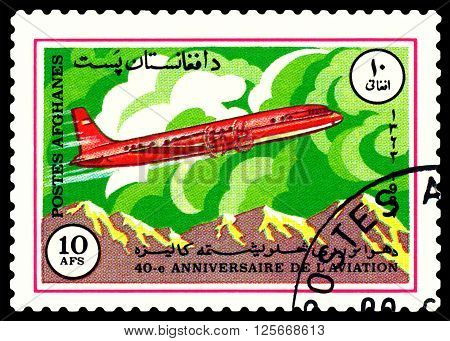 STAVROPOL RUSSIA - APRIL 05 2016: A stamp printed by Afghanistan shows old plane IL- 18 series Sovlet civil aircraft circa 1984