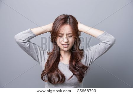 A Woman feel headache illness asian beauty . gray background