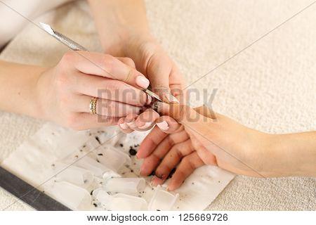 Nail polish removal process, close up view, top view