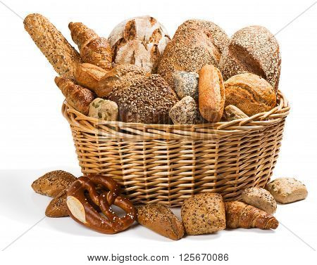 Big wicker basket full of different types of bread isolated on a white background.