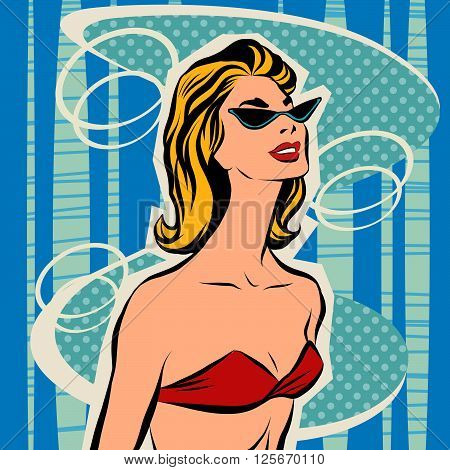 Beautiful girl sunbathes in bikini. Woman on the beach in the summer. Beachwear. Sunglasses and bra swimsuit