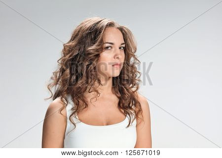The portrait of disgusted woman on gray