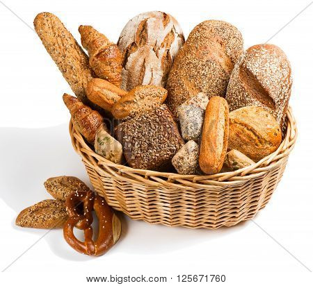 Bread assortment in a basket isolated on a white background.