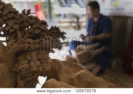 The Artisan Carving Wooden Sculpture Elephant Figurine