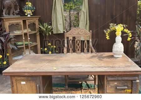 CHIANG MAI, THAILAND - APRIL 13: antique wooden chair and table at patio at 140-year-old Lanna Ancient House in Chiang Mai, Thailand on April 13, 2016.