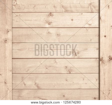 Side of wooden box, light planks or wall.