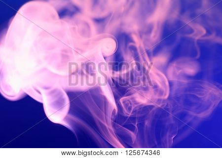 Abstract background with pink smoke on blue