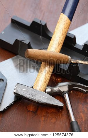 Set of carpenter tools on wooden workbench