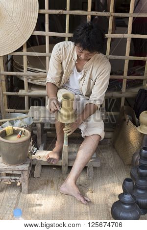 The Man Making Clay Pot