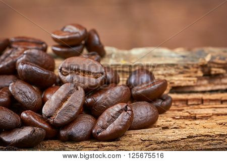 Roasted Coffee beans on wood background. Close-up