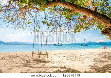 Swing hanging under the tree at Rang Yai island Phuket Thailand