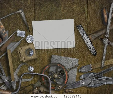 vintage jeweler tools and diamonds over wooden bench space for text on business card