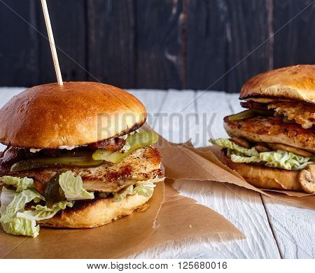 Healthy sandwiches with chicken breast, mushrooms, pickles and other vegies on wood background
