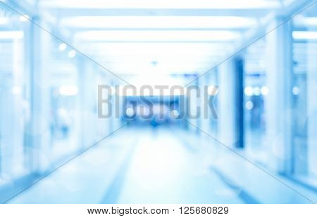 abstract defocused blurred background empty business corridor or shopping mall. Medical and hospital corridor defocused background with modern laboratory (clinic)