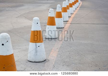 Line of traffic cones to prevent a driver not to drive off the safety zone.