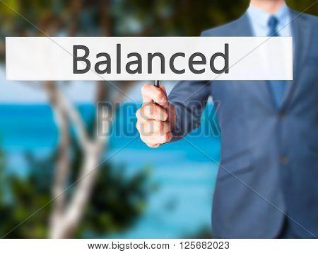 Balanced - Businessman Hand Holding Sign