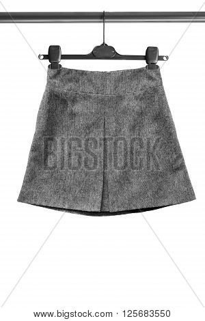 Gray tweed basic skirt on clothes rack isolated over white