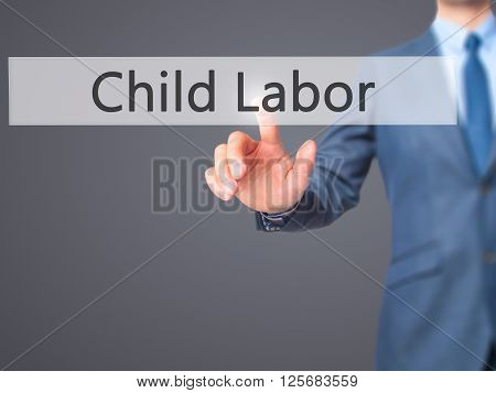Child Labor - Businessman Hand Pressing Button On Touch Screen Interface.