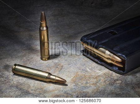 Ammunition for a semi automatic rifle on a rock with a magazine