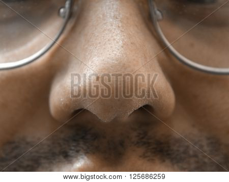Nose macro natural unshaven man's face skin spectacles and mustache
