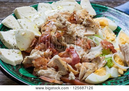 fresh chicken salad with mozarella cheese and boiled egg
