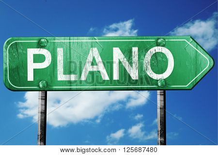 plano road sign on a blue sky background