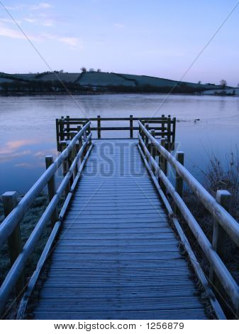 Pier And  Frozen Lake
