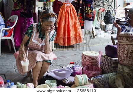 OAXACA MEXICO- MARCH 21, 2016: Woman resting with typical handicraft in a market in Oaxaca, Mexico