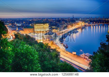 Beautiful View of the Dnieper river River station Havana bridge and Naberezhno-Kreschatitska street in Kiev Ukraine. Night panorama of Kyiv