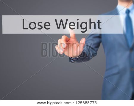 Lose Weight - Businessman Hand Pressing Button On Touch Screen Interface.
