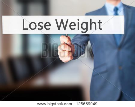 Lose Weight - Businessman Hand Holding Sign