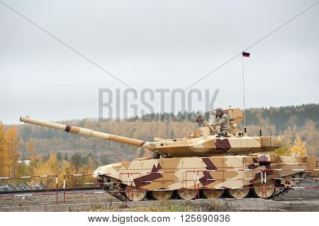 Nizhniy Tagil, Russia - September 27. 2013: Modernized tank T-90S moves on shooting demonstration range. Russia Arms Expo-2013 exhibition