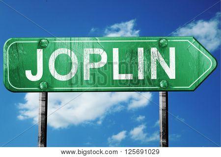 joplin road sign on a blue sky background