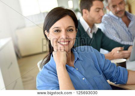 Smiling businesswoman attending meeting