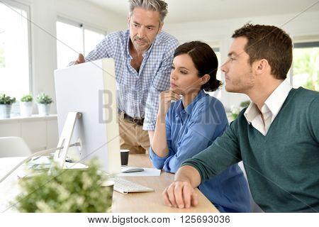 Business people working on desktop computer